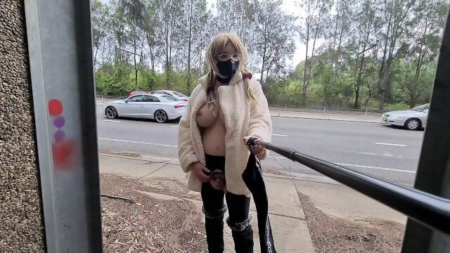 public boobs Exhibitionist whore flashing in a fur coat by a busy road